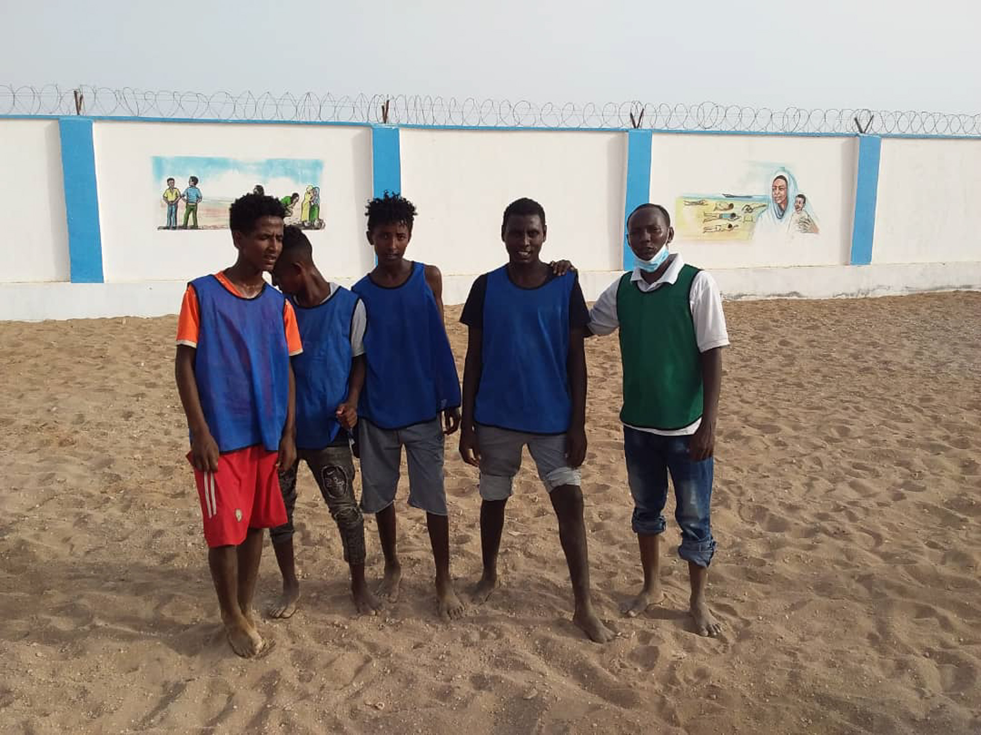 Kofi with some of his friends at the IOM-managed MRC in Obock. Photo: IOM/Alexander Bee
